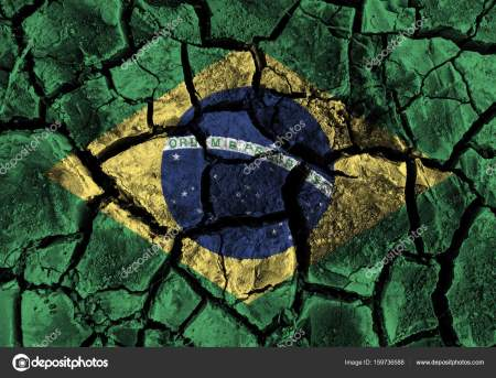 Brazil flag painting on high detail cracked ground .