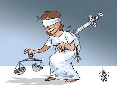 Charge2012-justica_apunhalada-700935